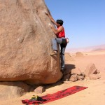 Mohammed Hammad on the granite boulders in front of Wadi Rum Horses stable.